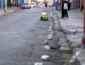 Stones set to mark parking spots, for which payment will be 'requested' (courtesy of The Gleaner)