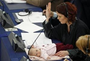 Denmark's member of the European Parliament Hanne Dahl and her baby attend a voting session at the European Parliament in Strasbourg