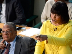 PM Portia Simpson-Miller, fronting finance minister, Dr. Peter Phillips, in her budget 2014/15 presentation