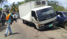 Disabled truck in Mount Rosser, stripped of its contents and some tyres