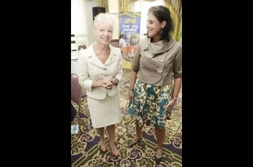 Kelly Tomblin, CEO of JPS; alongside Spain's Ambassador to Jamaica.