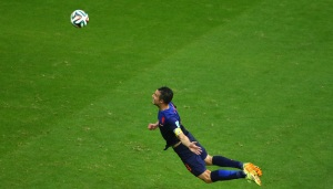 Van Persie in full flight to head his goal