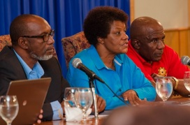 ED of NSWMA, flanked by other government officials during media briefing
